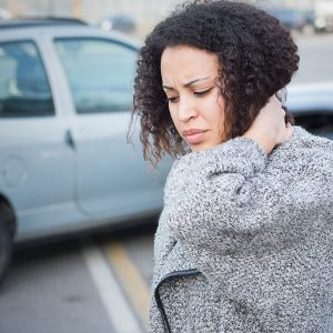 woman holding her neck due to a recent car accident