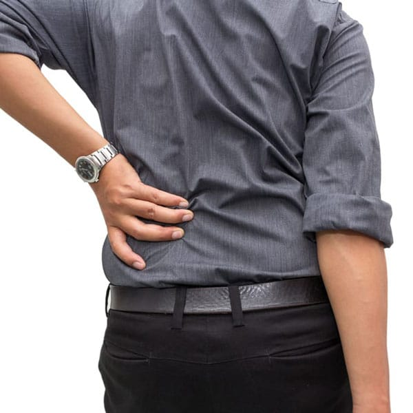 man holding his back due to pain