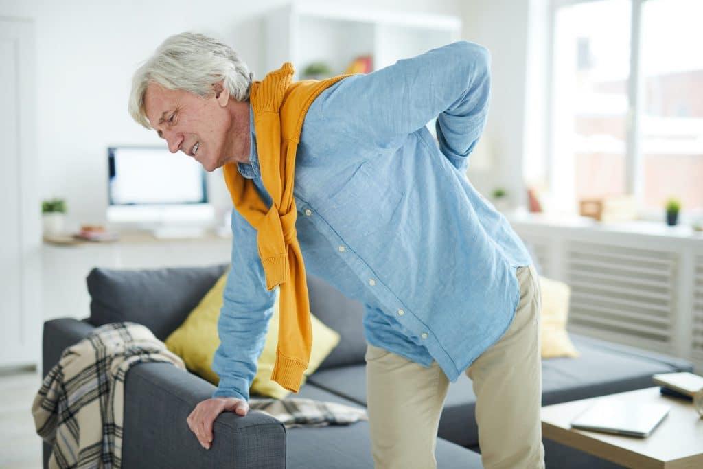 Elderly man having back pain