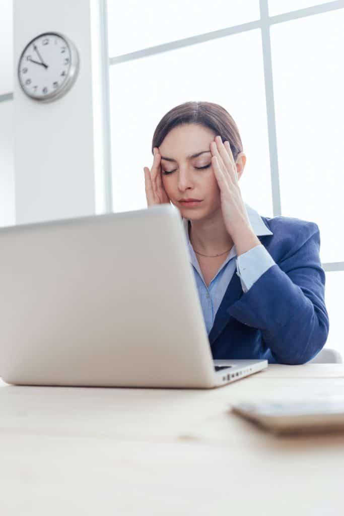 business woman having headaches at work