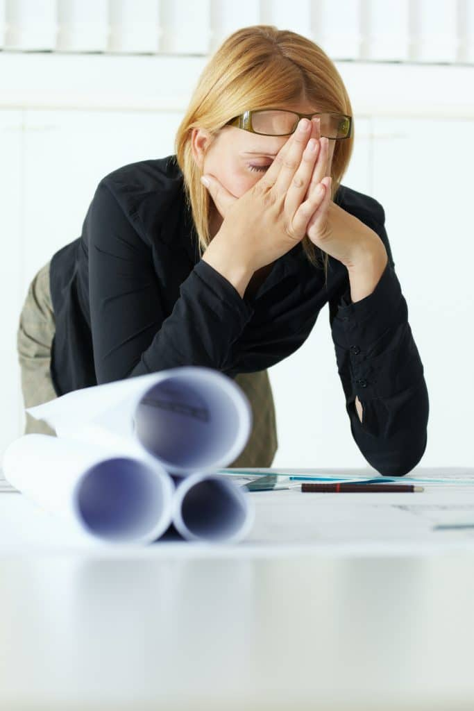 woman having headaches at work